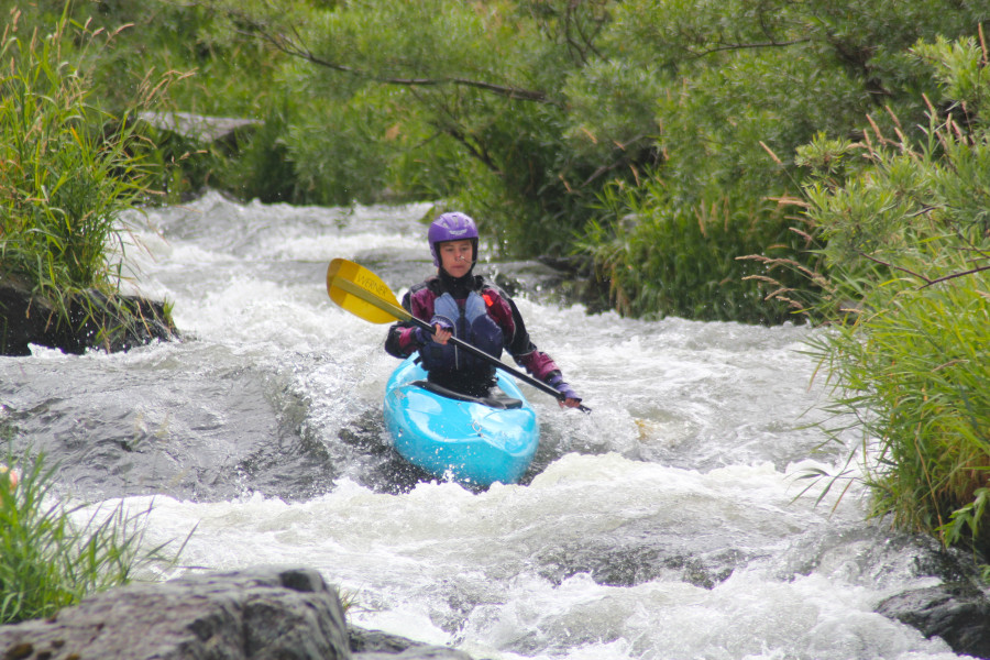 Zoe kayaking the fish ladder on the Rogue River