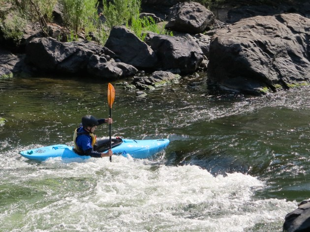 Paul Murtaugh surfing on of the many features in the Rogue River