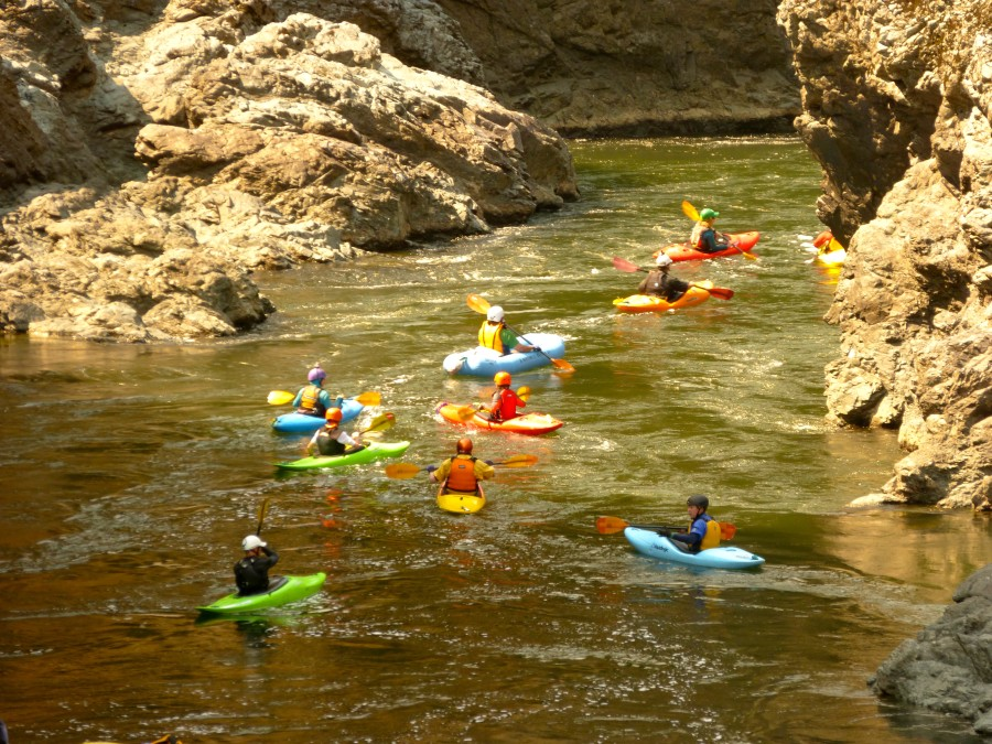 Kayaker paddling through Mule Creek Canyon